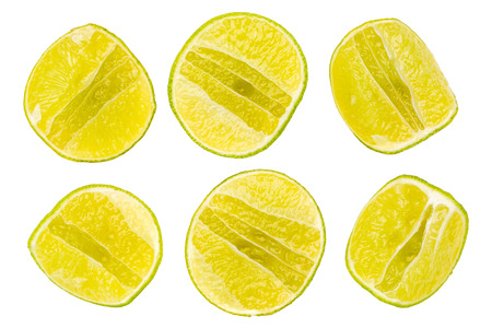 Juicy vertical slice pieces of green lime citrus on white background. Stock Photo