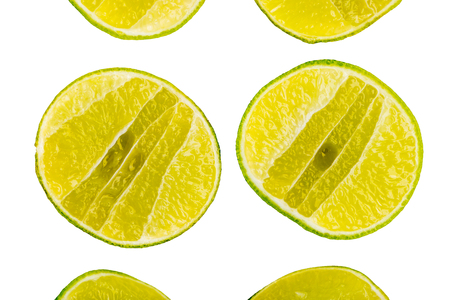 Juicy vertical slice pieces of green lime citrus on white background. Фото со стока