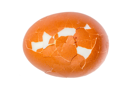 Detail texture of broken boiled egg isolated on white background.