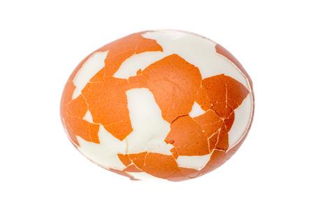 Cracked hard boil egg isolated on white background.