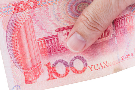 Detail of male hand holding hundred Chinese RMB banknotes on white background, business and finance concept. Фото со стока - 83491560
