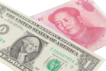 US dollar bill and Chinese yuan banknote on white background, USA and Chinese exchange rate concept. Stock fotó
