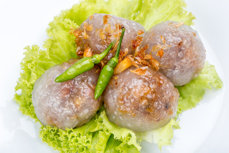 Tapioca sago balls with pork filling served with vegetable and chili, traditional Thai appetizer dish.