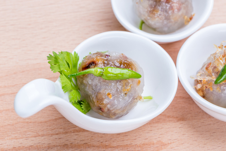 Sago balls filled with minced pork and sweet pickled radish served as canape, traditional Thai dessert dish. Stock fotó