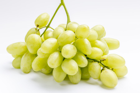 Fresh green grape bunch on white background, healthy food concept.