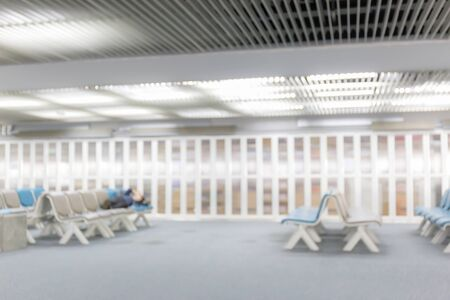 Blurred image of chairs in departure lounge of Airport terminal. Фото со стока