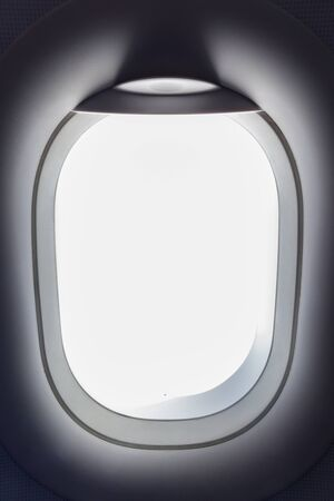 White light from airplane window, travelling concept.