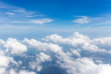 The big white fluffy clouds with magic shape in the blue sky, beautiful cloudscape.