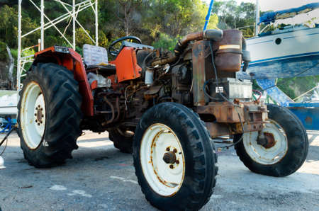 rusty red tractor with the engine uncovered 스톡 콘텐츠