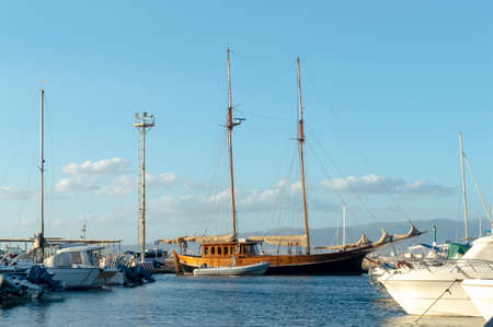 wooden boat moored in a dock in mediterranean sea 스톡 콘텐츠