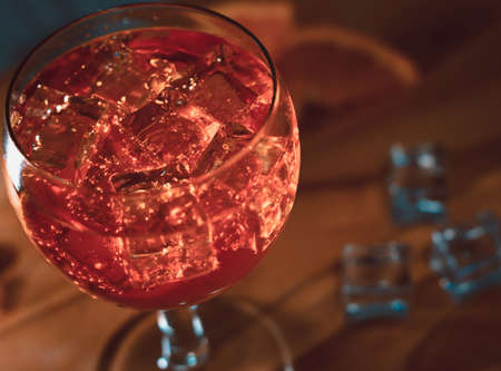 Italian spritz close up on wooden table with ice cubes and oranges aperitivo italiano classic