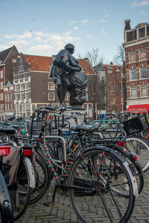 playwright: AMSTERDAM, HOLLAND - DECEMBER, 30: Bikes at the monument for the Dutch poet and playwright Gerbrand, Bredero. Bike is one of the most popular means of transportation in the city on 30 december 2012