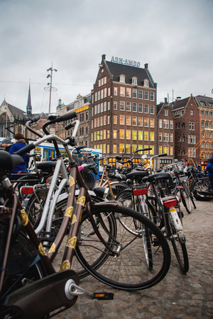 dam square: AMSTERDAM, HOLLAND - DECEMBER, 30: Bicycle Parking on DAM square, the Central square of Amsterdam, where there are famous buildings and hosts numerous events, one of the most famous and important places in the city on 30 december 2012. Editorial