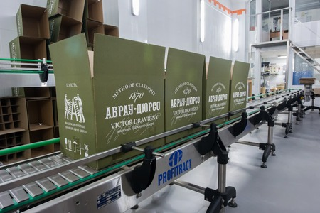 packaging equipment: ABRAY-DURSO, RUSSIA - SEPTEMBER, 15: Production line for the packaging of sparkling wines. Factory wine house Abrau-Durso has the latest equipment for production and packaging of sparkling wines on 15 september 2014