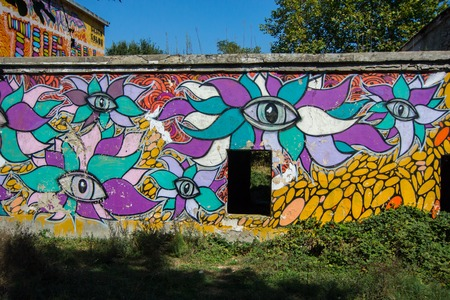 local landmark: ABRAY-DURSO, RUSSIA - SEPTEMBER, 15: Graffiti on an unfinished building. Destroyed buildings, turned into an art object are a local landmark on 15 september 2014