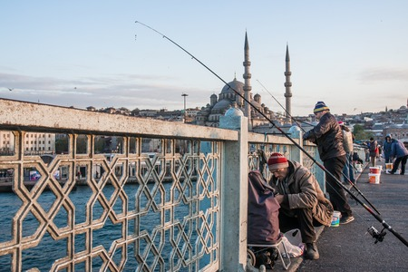 turkish ethnicity: ISTAMBUL, TURKEY - APRIL, 18: Fishermen on the Galata bridge on 11 april 2013