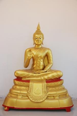 Buddha statues on white wall background Stock Photo - 15865216