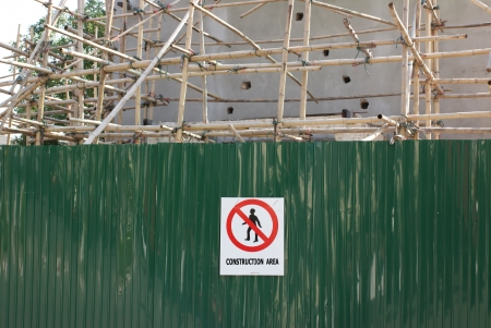 alarming: Warning and forbid sign fixed on zinc plate in construction area Stock Photo