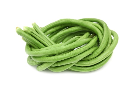 coiled: Green lentils,beans tied and coiled on white background Stock Photo