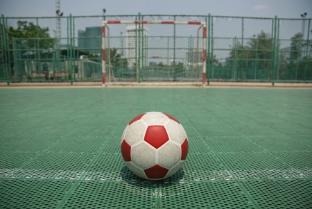 futsal: Grunge football in public outdoor field at Wachirabenchatat park,Bangkok,Thailand