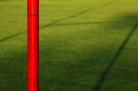 Shadow of Some Rugby Posts of a Green Pitch Stock Photo - 4944342