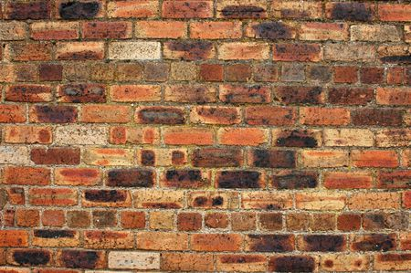 redbrick: Background image of an old, weathered red-brick wall Stock Photo