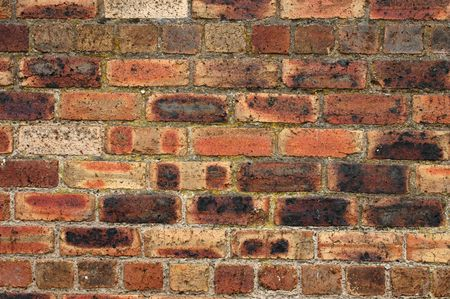 redbrick: Background image of a close-up of an old, weathered red-brick wall Stock Photo