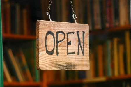 Retail and shopping image of an open sign in a book store window photo