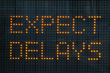 delay: Urban traffic congestion sign saying Expect Delays Stock Photo