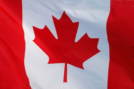canadian state flag: Close-up of a Canadian Flag Fluttering in the Wind Stock Photo