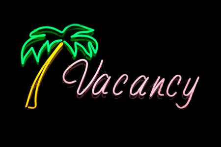holidays vacancy: Vacation Image of a Neon Vacancy Sign at a Hotel or Motel Reception