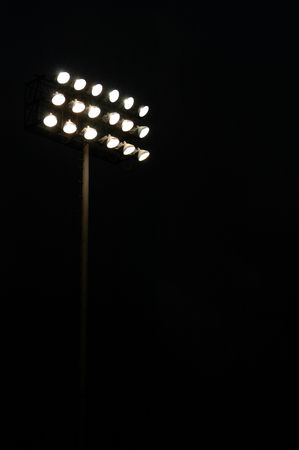 Stadium lights on a sports field at night with copy space Stock Photo