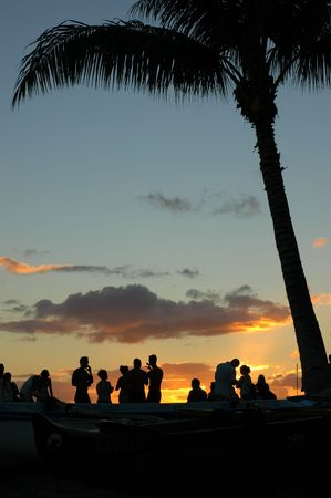 Vacation Image of Young People at a Beach Party During a Beautiful Summer Sunset Stock Photo