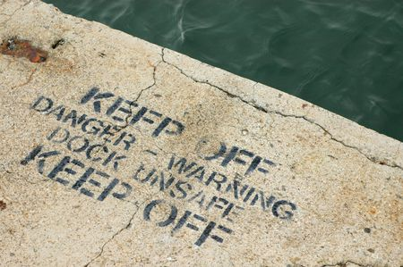 A Keep Off Warning Sign on an Unsafe Dock Stock Photo - 7582311