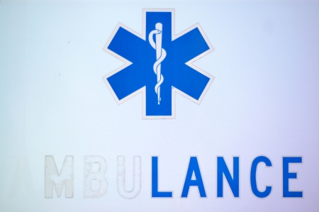 Medical Image Of Peeling Letters On An Ambulance Representing American Healthcare System photo