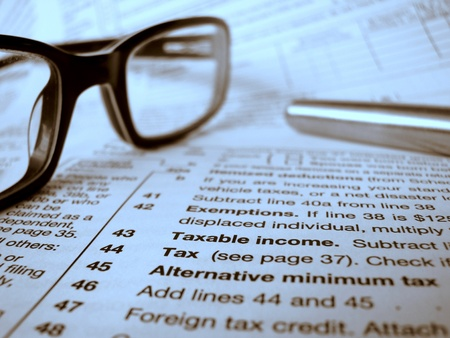 windfall: Financial Image Of A Tax Form, Pen And Glasses Stock Photo