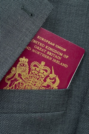 Business Travel Image Of A UK Passport In A Suit Pocket Stock Photo - 9140094
