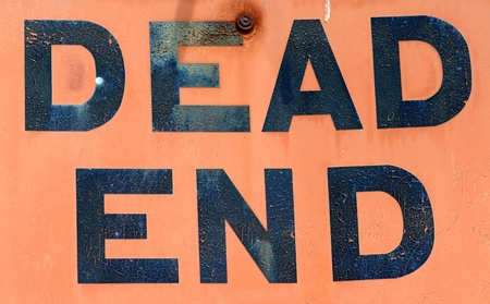 A Dirty, Grungy, Orange Dead End Sign photo