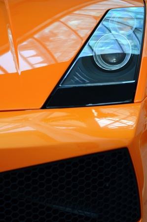 A Detail Of An Orange Sports Car Stock Photo - 9140097
