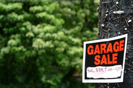 A Garage Sale Sign On A Telegraph Pole With Copy Space Stock Photo