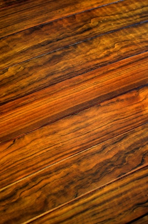 Abstract Background Of Dark Varnished Floorboards With Shallow DOF