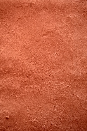 Abstract Background Texture of Grungy, Pink Terracotta Stucco Render Plaster