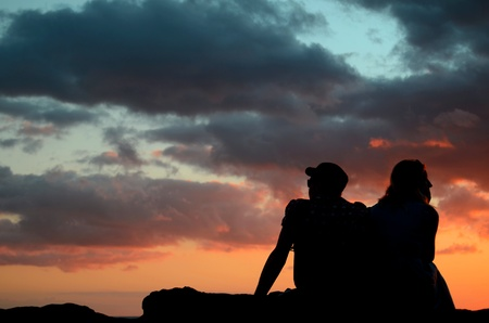 Romantic Image Of A Couple By The Beach At Sunset photo