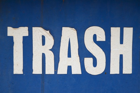 skip: A Grungy, Weathered Trash Sign On A Blue Background Stock Photo