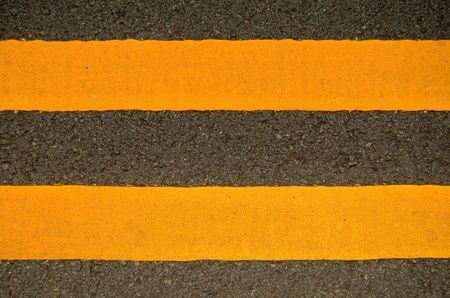 Traffic Image Of Double Yellow Lines On A Road photo