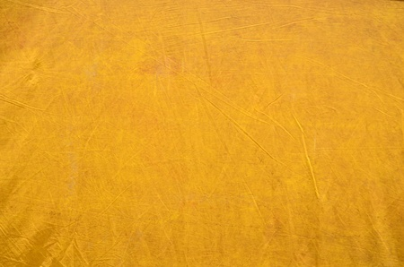 taut: Background Texture Of Grungy Taut Yellow Plastic Sheeting
