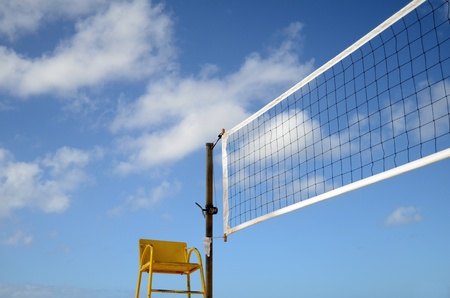 volleyball net: Sport Image Of A Volleyball Net On A Beach With A Referees Chair