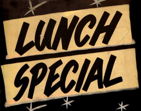A Grungy Lunch Special Sign In A Cafe Or Restaurant photo