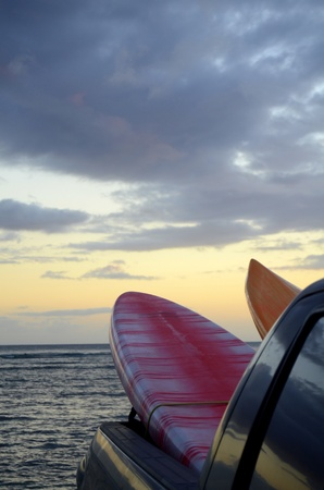 Two Surfboards In The Back Of A Truck At Sunset With Copy Space