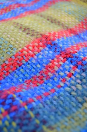 A Woven Woollen Picnic Blanket With Shallow Depth Of Focus photo